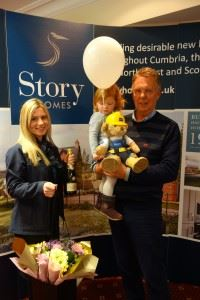 Neil Docherty  and his granddaughter celebrating the purchase